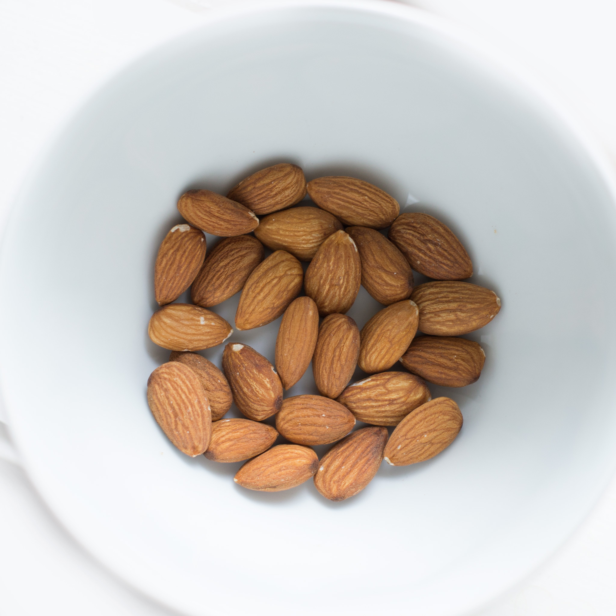 Canva - Brown Almond Nuts on White Ceramic Bowl