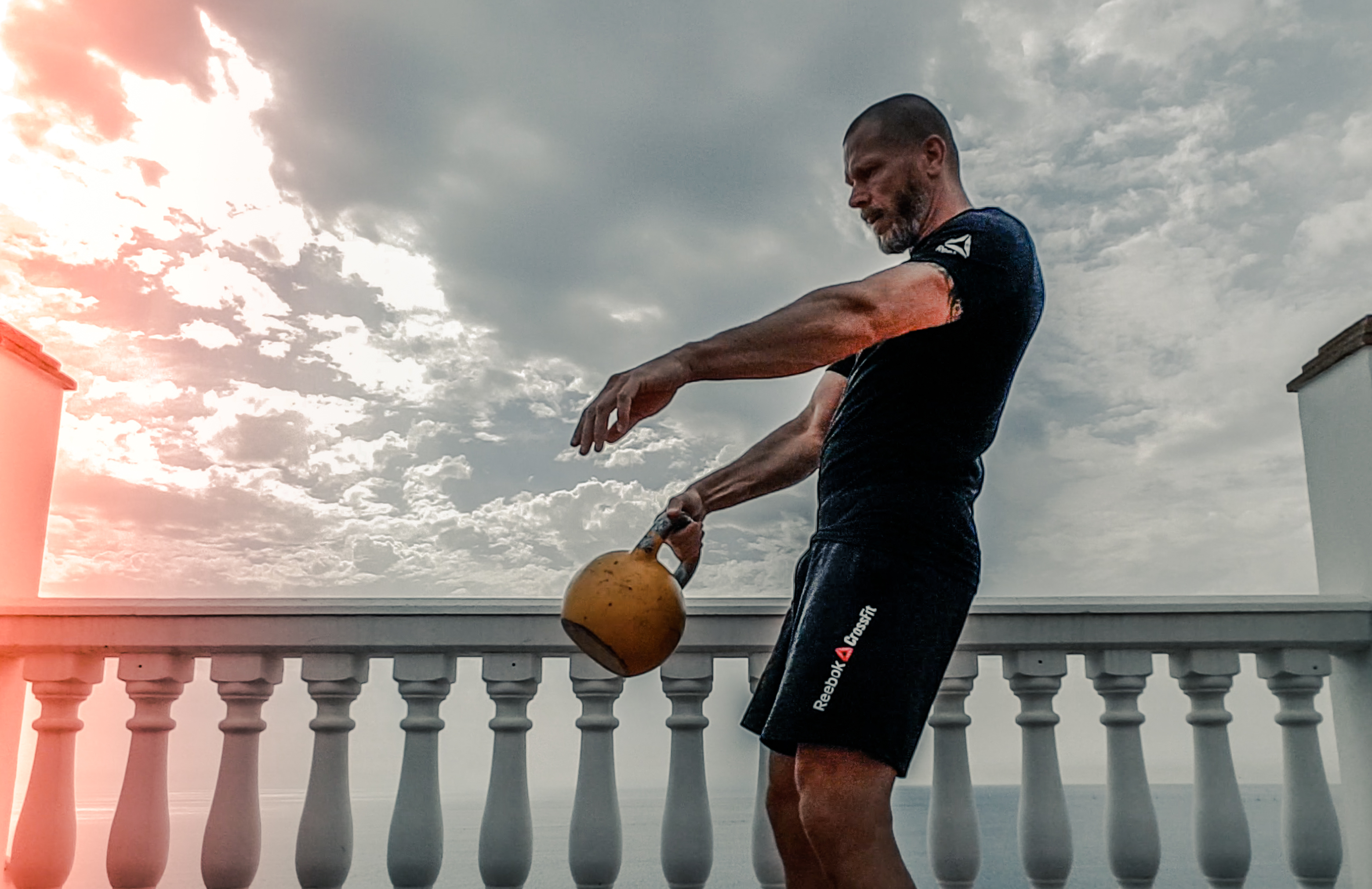 Canva - Man in Black Shirt Carrying Kettle Bell Outdoors